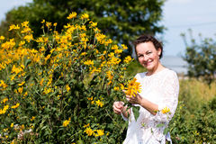 Nice girl and flowers. In a nice day Stock Image
