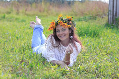 Nice girl and flowers. In a nice day Royalty Free Stock Images