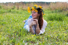 Nice girl and flowers. In a nice day Royalty Free Stock Photos