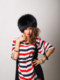 Nice girl in furhat Stock Photography