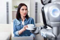 Nice girl getting cup of coffee Stock Image