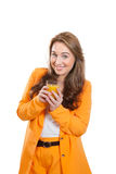 A nice girl with a glass of orange juice Stock Images