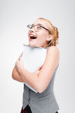 Nice girl in glasses extremely happy about success Royalty Free Stock Image