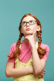 Nice girl in glasses thinking Stock Image