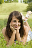 Nice girl on grass Stock Images