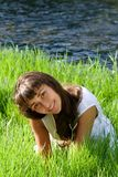 Nice girl on the grass near the river Royalty Free Stock Photo