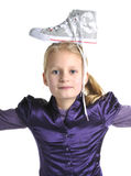 Nice girl have fun with her sneakers. On her head Stock Photos
