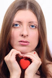 The nice girl having control over toy heart Stock Photography