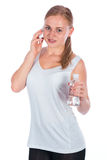 Nice girl holding a bottle of water Stock Photos