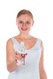 Nice girl holding a bottle of water Royalty Free Stock Photo