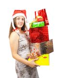 Nice girl holding coloured festive boxes Royalty Free Stock Images