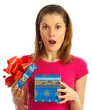 Nice girl holding a gift. Isolated on white. Royalty Free Stock Photo