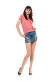 Nice girl in jeans mini skirt Stock Images