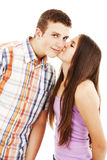 Nice girl kisses the young modest guy on a cheek Royalty Free Stock Photo