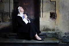 Nice girl like a nun Stock Photo