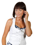 The nice girl listens to music Royalty Free Stock Photography