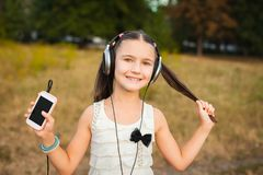 Nice girl with long hair listening song Stock Photos