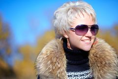Nice girl looking away from camera with a fur Royalty Free Stock Image