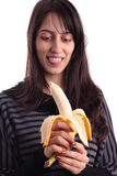 Nice girl looking a banana Stock Images