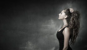 Nice girl looking in profile view royalty free stock photography