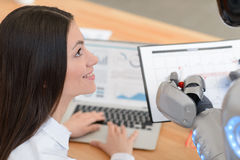 Nice girl looking at the robot Stock Photography