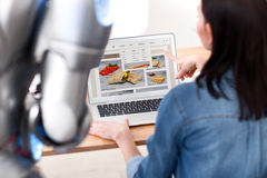 Nice girl looking through site with robot Royalty Free Stock Photography