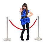 Nice girl near red rope barrier, stops someone with stop gesture Stock Images