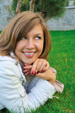 Nice Girl On Grass Royalty Free Stock Photography
