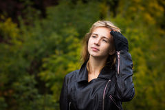 Nice girl outdoor. In an autumn day Stock Photos