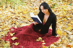 Nice girl outdoor with book Royalty Free Stock Photo