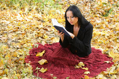 Nice girl outdoor with book Stock Images
