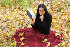 Nice girl outdoor with book Royalty Free Stock Images