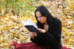 Nice girl outdoor with book Stock Image
