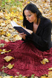Nice girl outdoor with book Royalty Free Stock Image