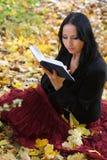 Nice girl outdoor with book Stock Photos