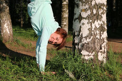 Nice girl in the park. And her physical training Stock Photos