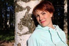 Nice girl in the park. In sunny day Stock Image