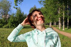 Nice girl in the park. In sunny day Royalty Free Stock Photos