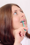 The nice girl with a pencil Royalty Free Stock Image