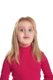 Nice girl in a pink sweater ridiculous grimaces stock image