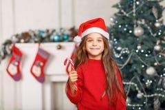 Nice girl playing near Christmas tree Stock Images