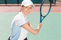 Nice girl playing tennis Royalty Free Stock Photography