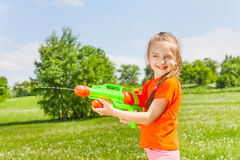 Nice girl playing with water gun Stock Photography