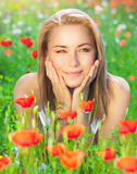 Nice girl on poppy meadow royalty free stock images