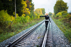 Nice girl and rails in autumn Royalty Free Stock Photo
