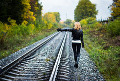 Nice girl and rails in autumn Royalty Free Stock Photography