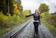 Nice girl and rails in autumn Royalty Free Stock Photos