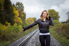 Nice girl and rails in autumn Stock Image