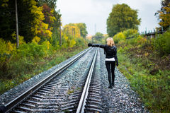 Nice girl and rails. In autumn day Stock Photography
