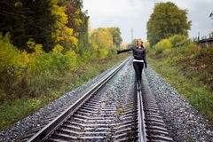 Nice girl and rails. In autumn day Stock Image